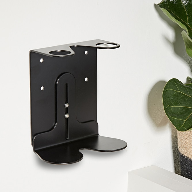 A double black wall mounted dispenser holder